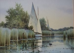 Sailing boat cruising on the Norfolk Broads Colin Burns